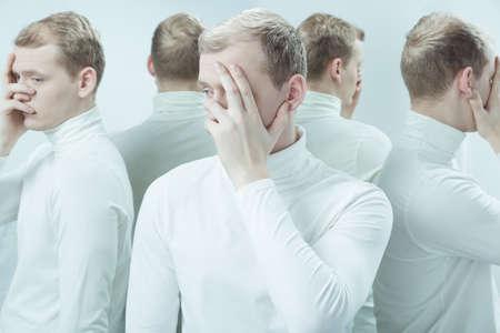 Schizophrenic man with visual hallucinations in psychiatric hospital. Man having split personality