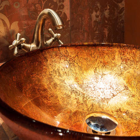 expensive: View of golden sink in expensive bathroom