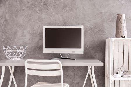 white work: White minimalist place to work with concrete wall Stock Photo