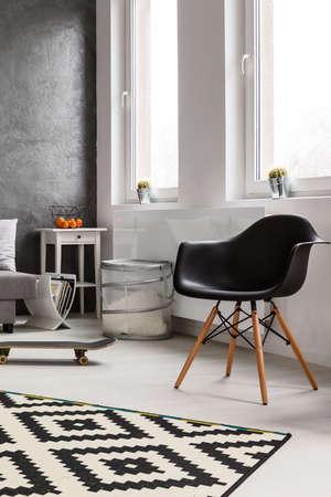 aerodynamic: Black aerodynamic armchair in loft designed room Stock Photo