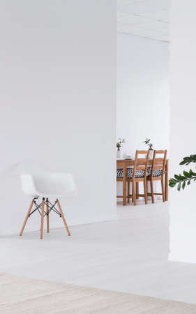 white interior: White clear spacious interior with wooden dining table Stock Photo