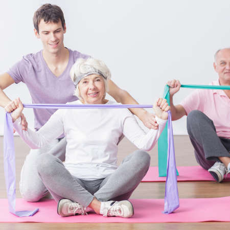 fitness training: Picture of fit mature couple with their personal trainer