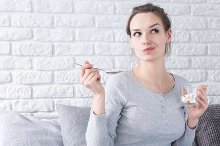 woman eat: Drugs instead of meal- addicted to supplements and vitamins