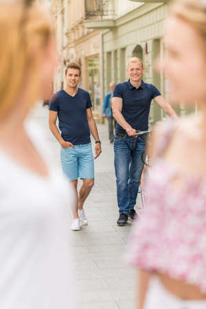 Shot of two handsome men on their way to meet up with their friends