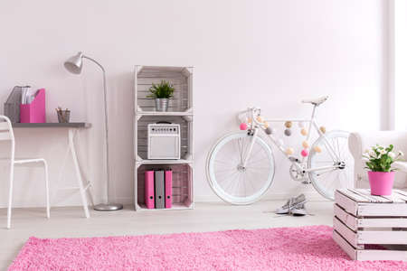 white work: Female inspiring work space with white crate furniture Stock Photo