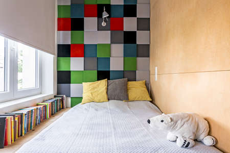 bedroom wall: Cropped shot of a small bedroom interior with colorful decoration on the wall