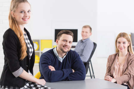 open space: Four employees sitting at open space in the office and smiling Stock Photo