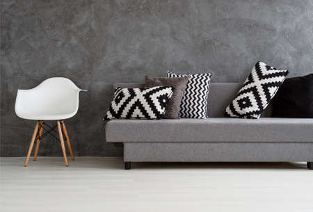 living room wall: Minimalist living room with trendy concrete wall Stock Photo
