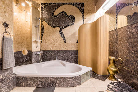 granite wall: Very luxurious bathroom with granite walls and marble floor, with wall mosaic