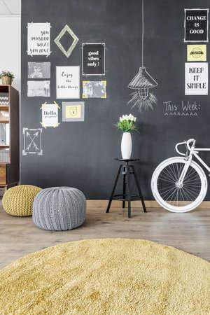 interior home: Modern home interior with blackboard wall and bike