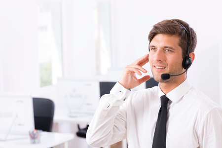 telemarketer: Cropped shot of a handsome telemarketer talking with a customer