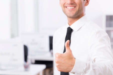 Cropped shot of a young employee showing a thumb up