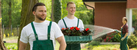 Shot of a team of young gardeners working in a garden Stock Photo