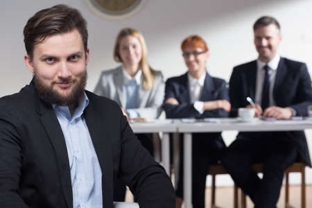 recruiters: Male job applicant remains confident and happy after the conversation with recruiters