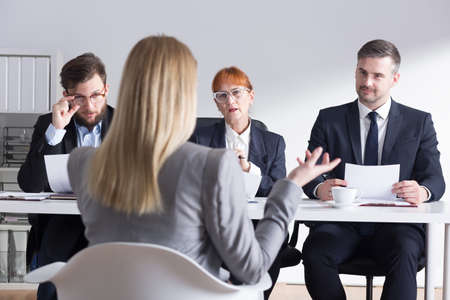 seeker: Female job applicant answering the recruiters question Stock Photo