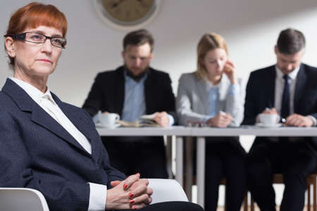 recruiters: Female job applicant waiting intently for  the opinion of recruiters