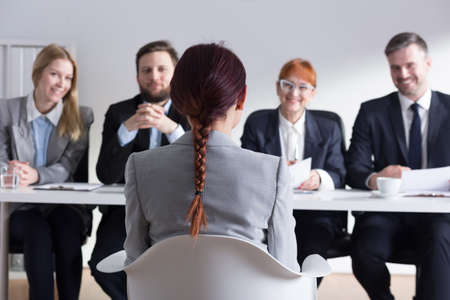 seeker: Recruiters listening intently to female job applicant