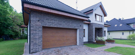 garage on house: Shot of a detached house and a big garage