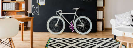 decorated bike: Shot of a small functional studio decorated with a bike Stock Photo