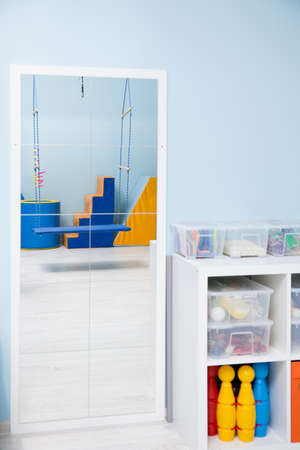 sensory: Rack with sensory therapy equipment and a mirror