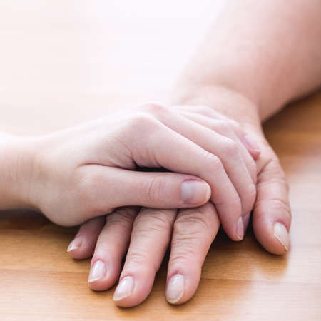 female hands: Touching hands - gesture of support and care