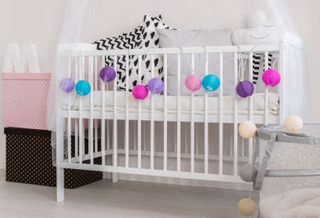 adorable child: Part of adorable room for a child with a crib and boxes