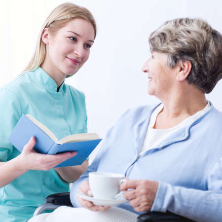 cheerfulness: Image of professional caregiver and elderly cheerfulness patient