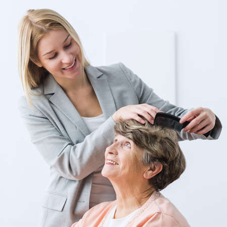 afflictions: Image of helpful woman take care of ill grandmother
