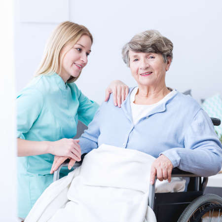 old carer: Image of old lady with walking problem and her carer