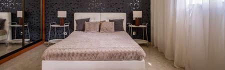 headrest: Panoramic shot of a minimalistic bedroom interior