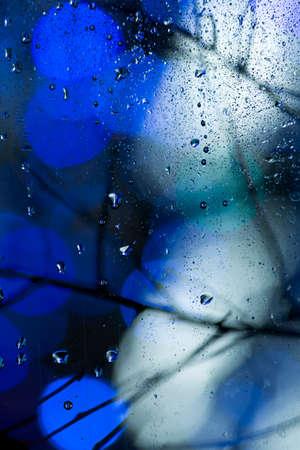 closeup view: Close-up of rainy illumination- view through rainy window