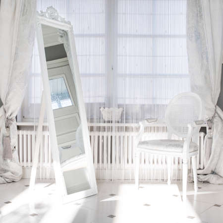 mirror: Big white mirror in the middle of luxury white room