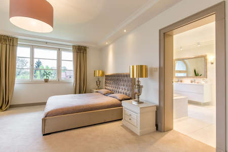 bedroom suite: Very stylish bedroom suite with bathroom arranged in classic, decorative style