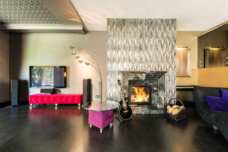 fireplace living room: Shot of a modern living room with a stylish fireplace