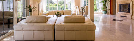 leather furniture: Panoramic shot of a spacious living room with leather furniture set Stock Photo