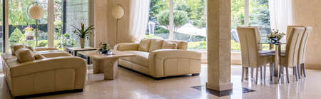 interior shot: Shot of a very elegant and luxury living room interior with rectangular table Stock Photo