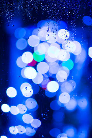 spot lights: Water drops on window and spot light behind Stock Photo