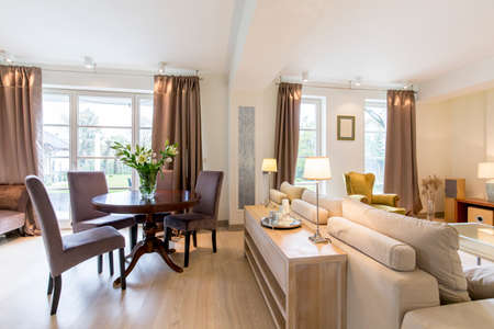 classic living room: Elegant living room with a large sofa and a round, classic coffee table in a spacious house interior