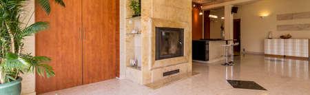 granite floor: Panoramic shot of a spacious interior with granite floor designed in bright tones