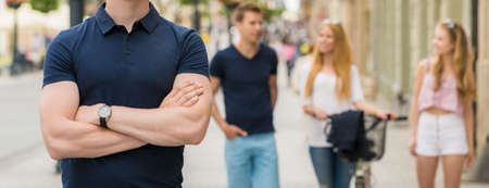 body torso: Close-up of young man standing on the street