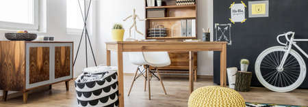 sideboard: Shot of a stylish office with a wooden retro sideboard