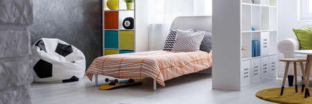 bedcover: Modern interior with white rack separating different living spaces