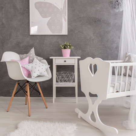 bassinet: Shot of a modern grey baby room with white accessories