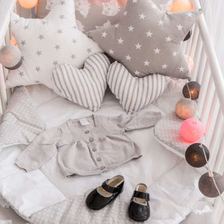 girl shoes: Shot of a decorated crib in a modern baby room Stock Photo