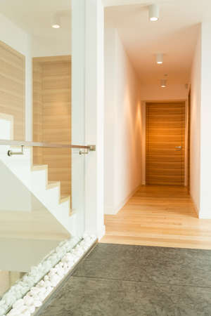 balustrade: Modern house hall interior and staircase with glass balustrade