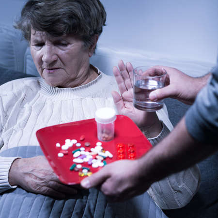 refusing: Picture of an old woman refusing to take her medication
