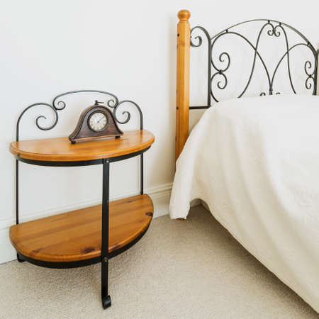 nightstand: Wooden bed and nightstand with ornamental iron elements