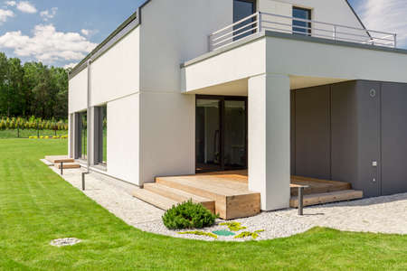 Front of modern rectangular house with spacious balcony