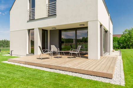 Wooden patio design- small terrace idea for modern house Archivio Fotografico