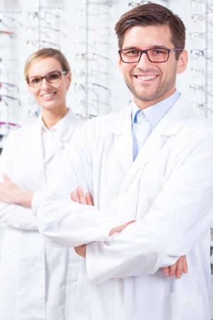 specialists: Portrait of opticians specialists at optical retail store